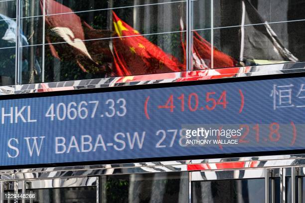 Stock activity of the Alibaba Group Holding Ltd is displayed outside the Exchange Square towers in Hong Kong on November 4 after a last minute...