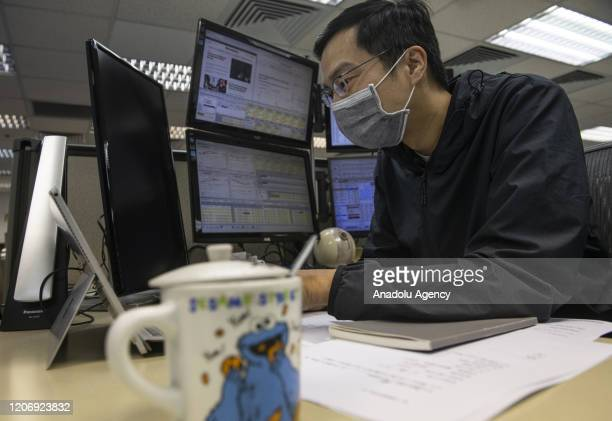 Stock broker at the Prudential Brokerag office follows the Hang Seng Index results in Hong Kong on March 13 2020 World markets have plunged by fears...