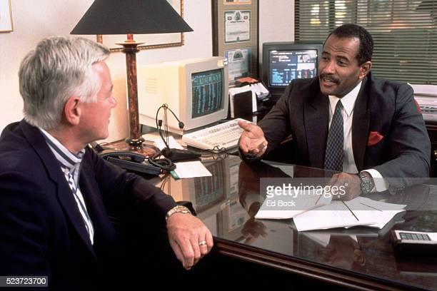 Stock brokers conferring