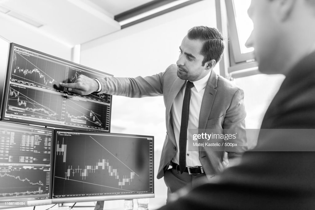 Stock Brokers Looking At Computer Screens Trading Online High Res Stock Photo Getty Images