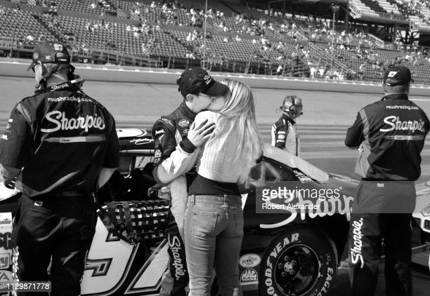 NASCAR stock car driver Kurt Busch kisses his girlfriend and future wife Eva Bryan prior to the start of the 2005 Daytona 500 at Daytona...