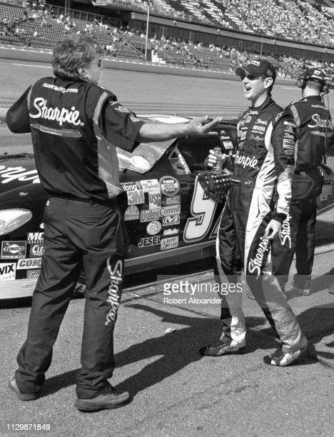 NASCAR stock car driver Kurt Busch talks with a member of his crew prior to the start of the 2005 Daytona 500 at Daytona International Speedway in...