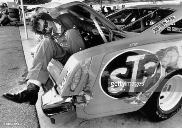 Stock car king Richard Petty hasn't developed a new exit for his Oldsmobile he's sitting in the trunk kicking our the side of his rear fender after...