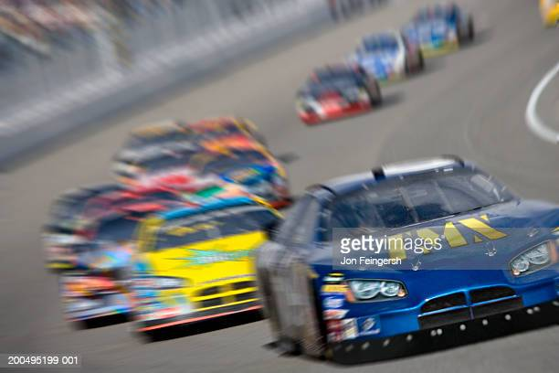 stock car race (digital composite, digital enhancement) - nascar stock pictures, royalty-free photos & images
