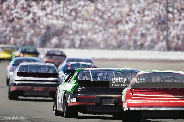 stock car race, rear view - nascar stock pictures, royalty-free photos & images