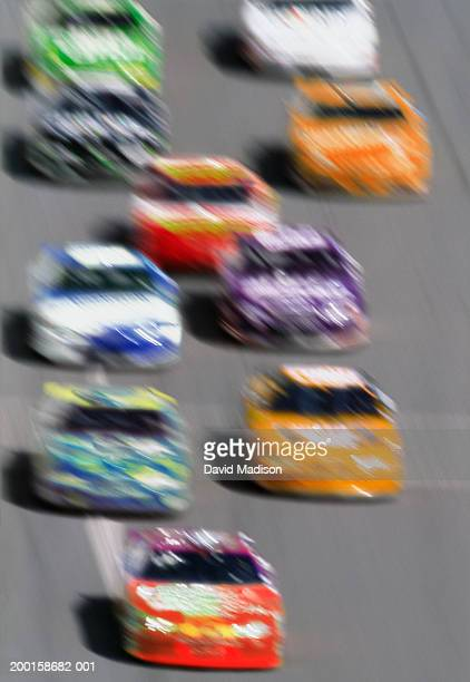 stock cars on straight-away, elevated view (blurred motion) - nascar stock pictures, royalty-free photos & images