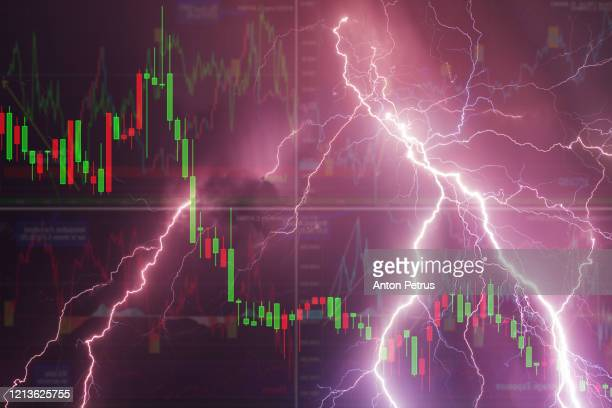 stock charts against the sky with lightning. world financial crisis concept - graphic accident photos stock pictures, royalty-free photos & images