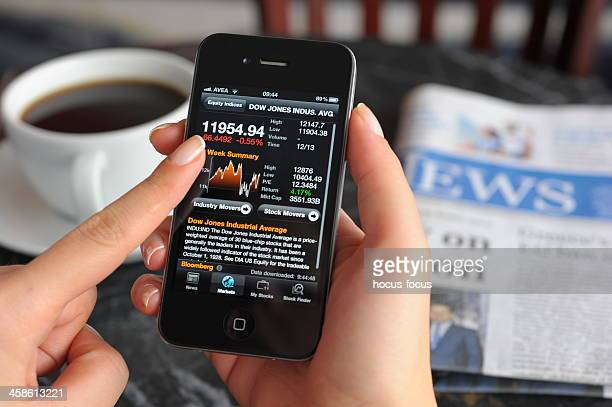 stock charts on iphone 4 - dow jones industrial average stock pictures, royalty-free photos & images