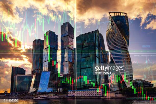 stock charts on the background of skyscrapers. financial system concept - crisis stock pictures, royalty-free photos & images