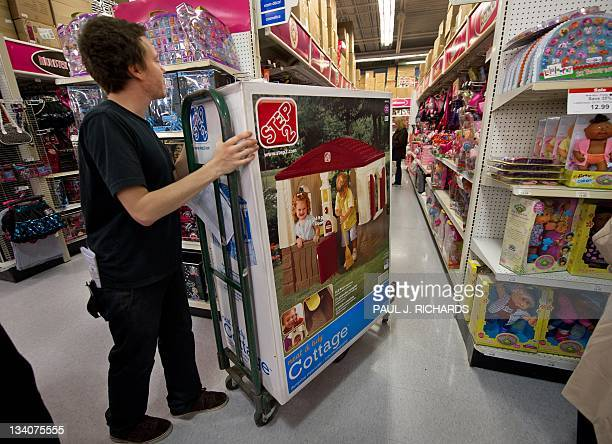 Stock clerk working on Black Friday moves merchandise into position at the Toys-R-Us store at Fair Lakes Shopping Center late November 24, 2011 in...