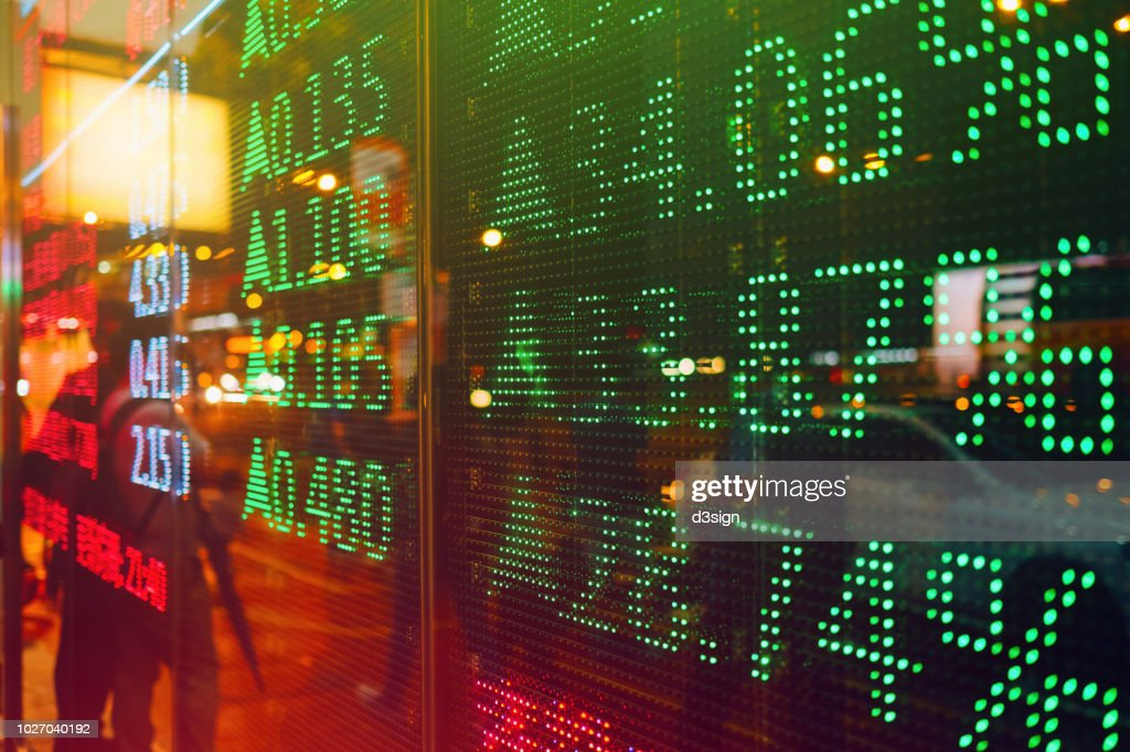 Stock exchange market display screen board on the street showing stock rises in green colour : Stock-Foto