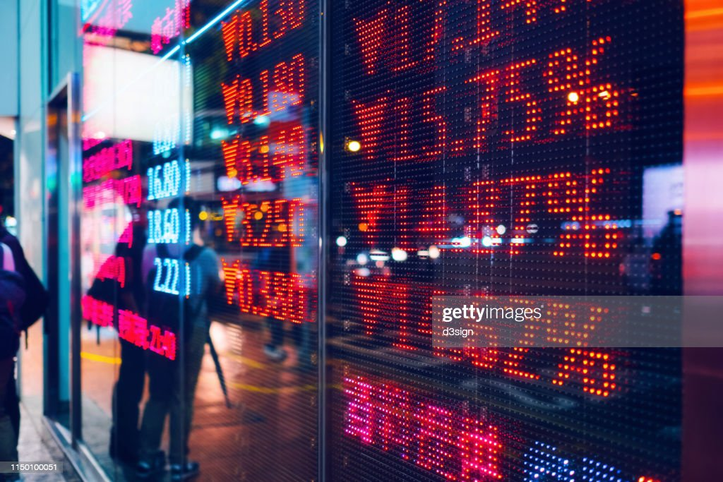 Stock exchange market display screen board on the street showing stock market crash sell-off in red colour : Stock-Foto