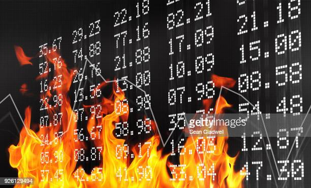 stock exchange numbers and flames - dow jones industrial average stock pictures, royalty-free photos & images