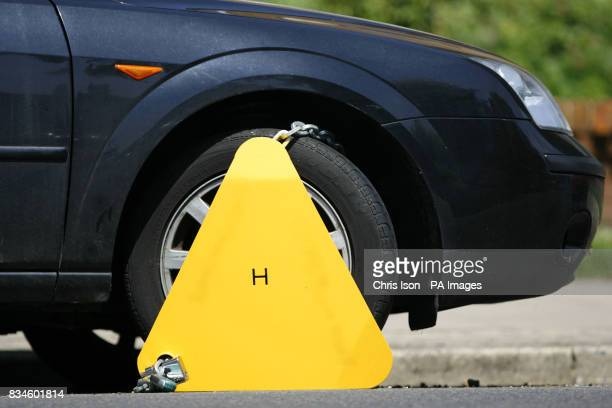 Stock image of a car incapacitated by a wheel clamp