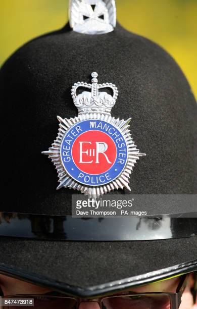 Stock image of a Greater Manchester Police badge on an officers helmet as he waits for the arrival of Queen Elizabeth II at Manchester Town Hall The...