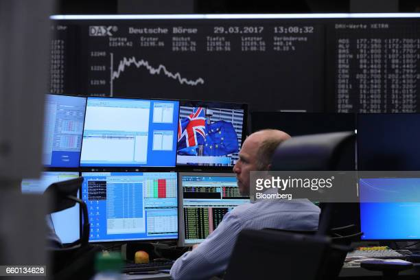 A stock index curve sits on a display screen behind a financial trader at the Frankfurt Stock Exchange operated by Deutsche Boerse AG following the...