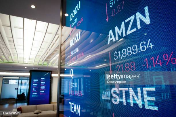 Stock information about Amazon is displayed on a monitor inside Nasdaq's new 'Client Experience Center' at their office in Times Square May 2 2019 in...