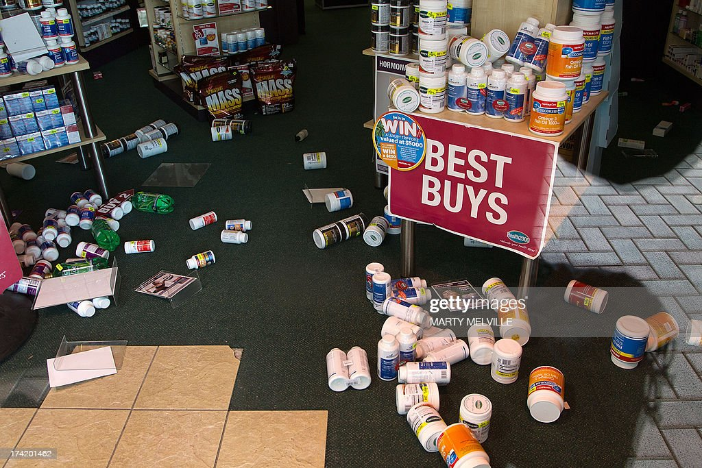 Stock lays on the ground inside a retail store in Wellington on July 22, 2013 following an earthquake on July 21