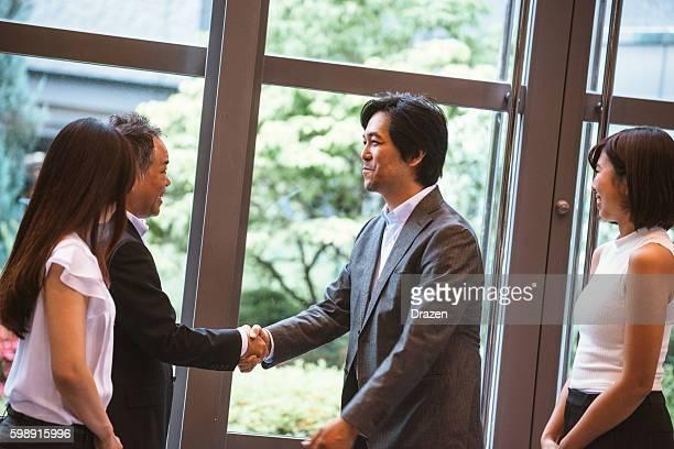 Stock market brokers and agents handshake