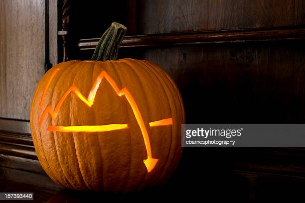 stock market crash chart on Halloween pumpkin