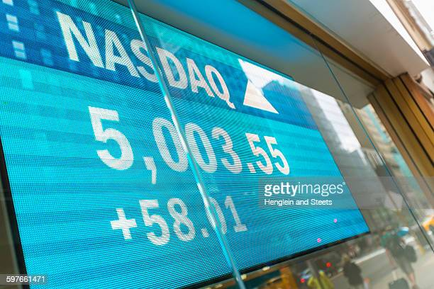 Stock market data screen in window, New York, USA