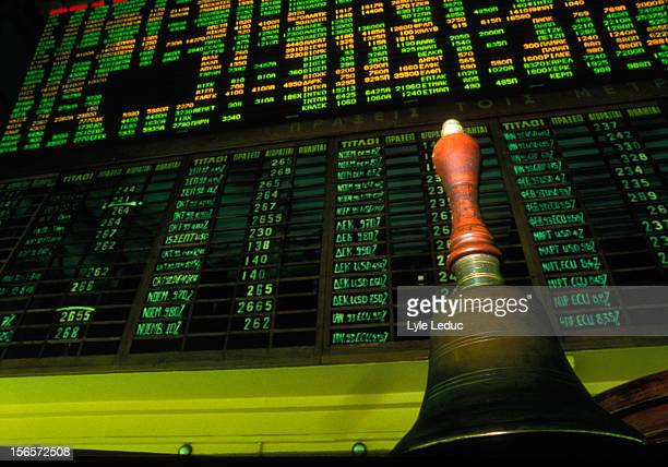 stock market display board with opening bell - campana fotografías e imágenes de stock