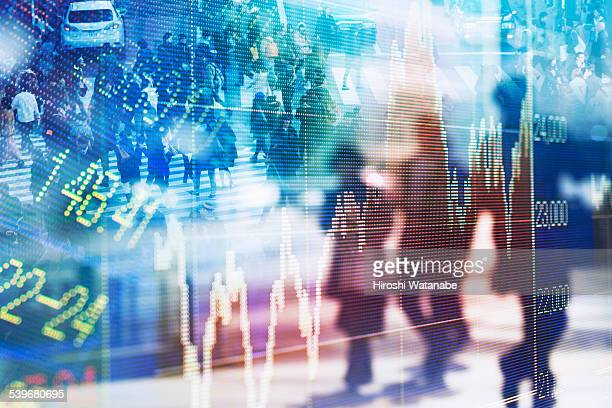 Stock market graph with walking business men