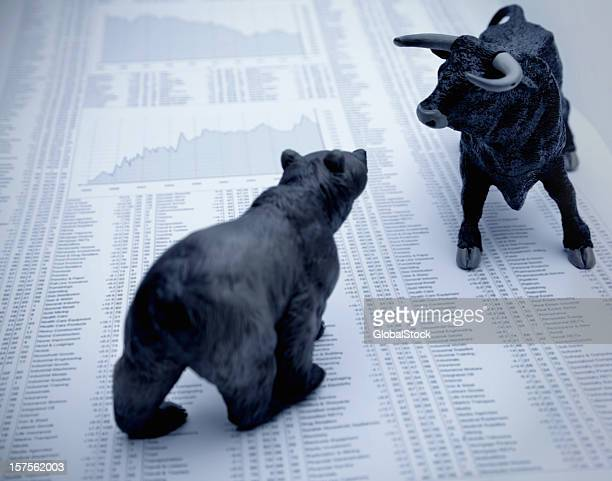 stock market report with bull and bear - bull animal stock photos and pictures