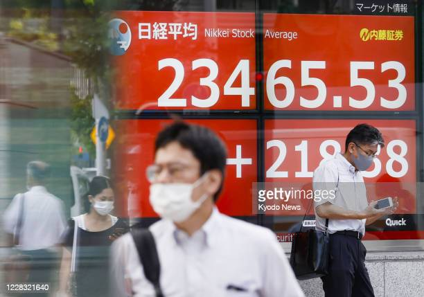 Stock monitor in Tokyo shows the Nikkei Stock Average ending at its highest level in six and a half months on Sept. 3 recovering to figures seen...