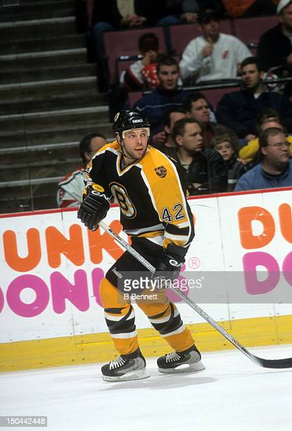 J Stock of the Boston Bruins skates on the ice during an NHL game against the New Jersey Devils circa 2002 at the Continental Airlines Arena in East...