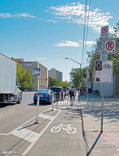 Stock Photo of Downtown Saskatoon Protected Bike Lane With Cyclist