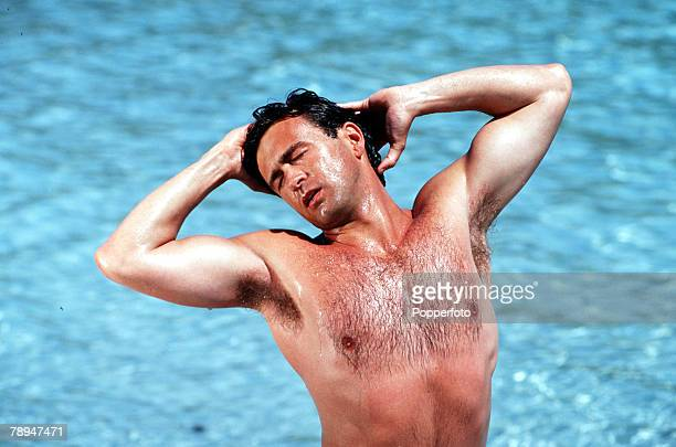 Stock Photography, Fit and healthy looking bare chested man stretches with his arms behind his head