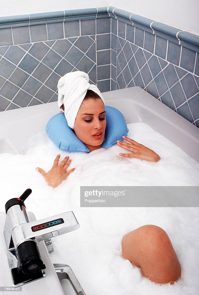 Stock Photography. Young woman enjoying a therapeutic foam spa bath ...
