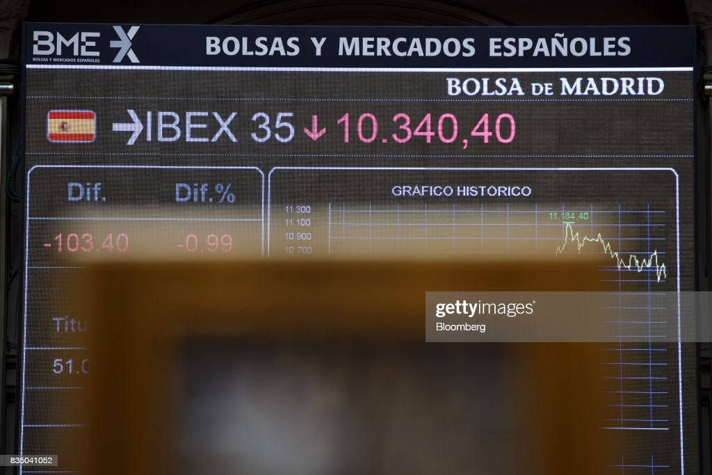 Stock price information for the IBEX 35 index sits on electronic screens inside the Madrid stock exchange, also known as Bolsas y Mercados Espanoles, the day after the Barcelona terror attack in Madrid, Spain, on Friday, Aug. 18, 2017. Terrorists behind the Barcelona attack had planned a devastating assault with explosives and may have rammed pedestrians with vehicles after their initial plan failed, the police chief heading the investigation said on Friday. Photographer: Angel Navarrete/Bloomberg via Getty Images