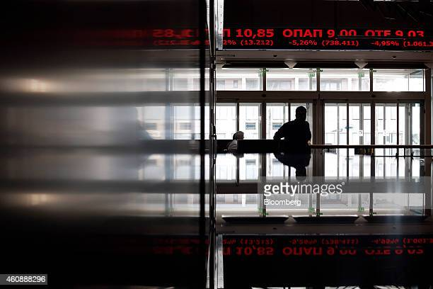 Stock prices pass along a digital ticker screen inside the Hellenic Stock Exchange as stock and bonds plunged after the government was defeated in a...