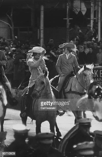 Stock show queen Judy Johnston riding a horse during parade