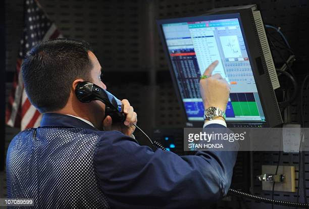 Stock specialist works at a trading post on the floor of the New York Stock Exchange November 23, 2010 after the opening bell. US stocks fell Tuesday...