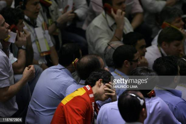 A stock trader assistant gestures in the iBovespa future index pit during the morning session at the Mercantile Futures Exchange in Sao Paulo Brazil...