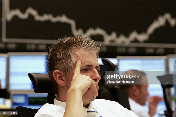 Stock trader Dirk Mueller is seen working at the German Stock Exchange on August 16 2007 in Frankfurt Germany The European stock market plunges after...