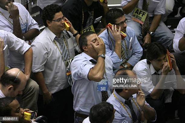 A stock trader reacts as he negotiates in the iBovespa future index pit during the morning session at the Mercantile Futures Exchange in Sao Paulo...