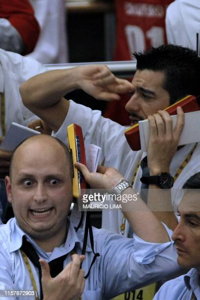 Stock traders are seen in the iBovespa future index pit between the first and the second automatic cutoff called circuit breaker when the Ibovespa...