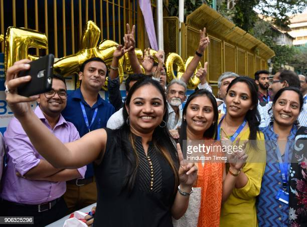 Stock traders celebrate as Sensex creates history by crossing 35000 mark outside Bombay Stock Exchange on January 17 2018 in Mumbai India Stock...