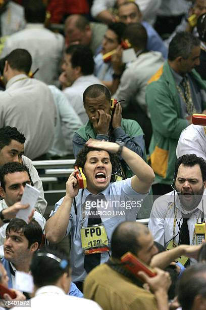 Stock traders negotiate during the morning session at the Mercantile Futures Exchange in Sao Paulo Brazil 30 August 2007 Global stocks rose on...