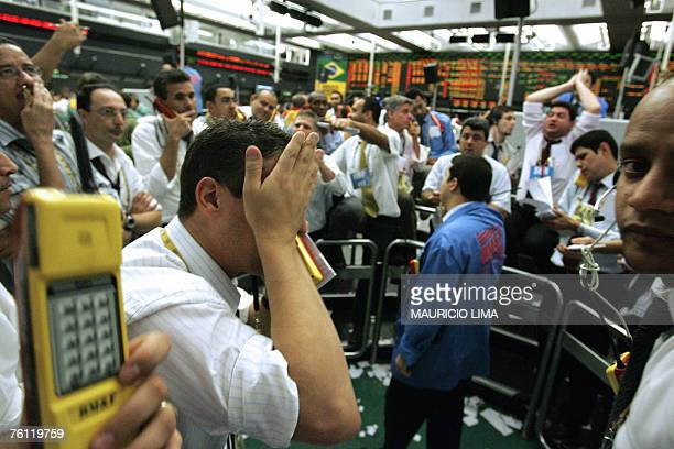 Stock traders negotiate in the coffee pit during the morning session of the Mercantile Futures Exchange BMF in Sao Paulo Brazil 16 August 2007 World...