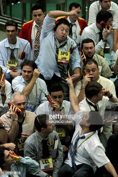 Stock traders negotiate in the future dollar pit during the morning session at the Mercantile Futures Exchange in Sao Paulo Brazil on October 9 2008...