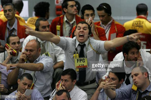 Stock traders negotiate in the future dollar pit during the morning session at the Mercantile Futures Exchange in Sao Paulo Brazil on September 23...
