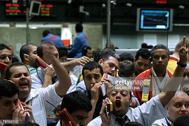 Stock traders negotiate in the future dollar pit during the morning session at the Mercantile Futures Exchange in Sao Paulo Brazil 18 January 2008...