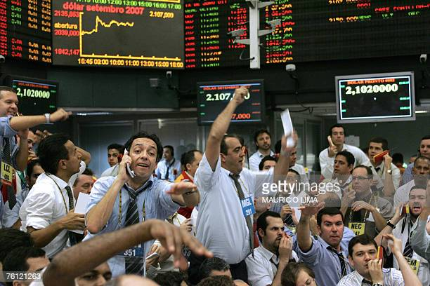 Stock traders negotiate in the future dollar pit which has been quoted by 210 reals per US dollar during the morning session at the Mercantile...