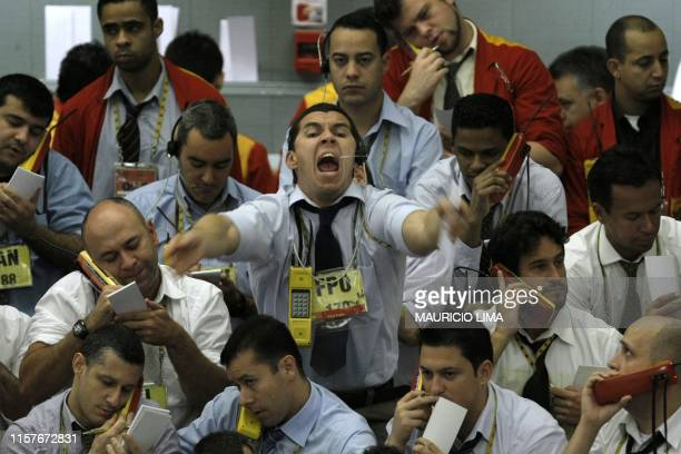 Stock traders negotiate in the iBovespa future index pit during the morning session at the Mercantile Futures Exchange in Sao Paulo Brazil on October...