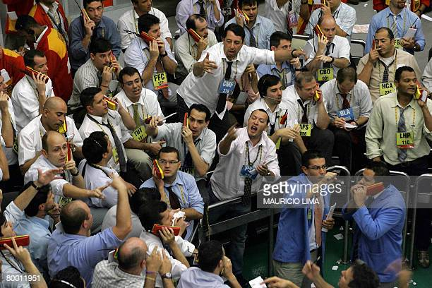 Stock traders negotiate in the iBovespa future index pit during the morning session at the Mercantile Futures Exchange in Sao Paulo Brazil on...